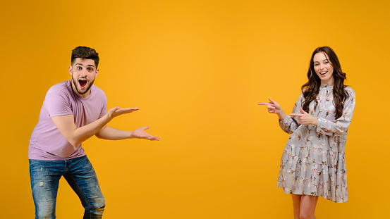 istock Young man and woman isolated over bright yellow background 1161752721