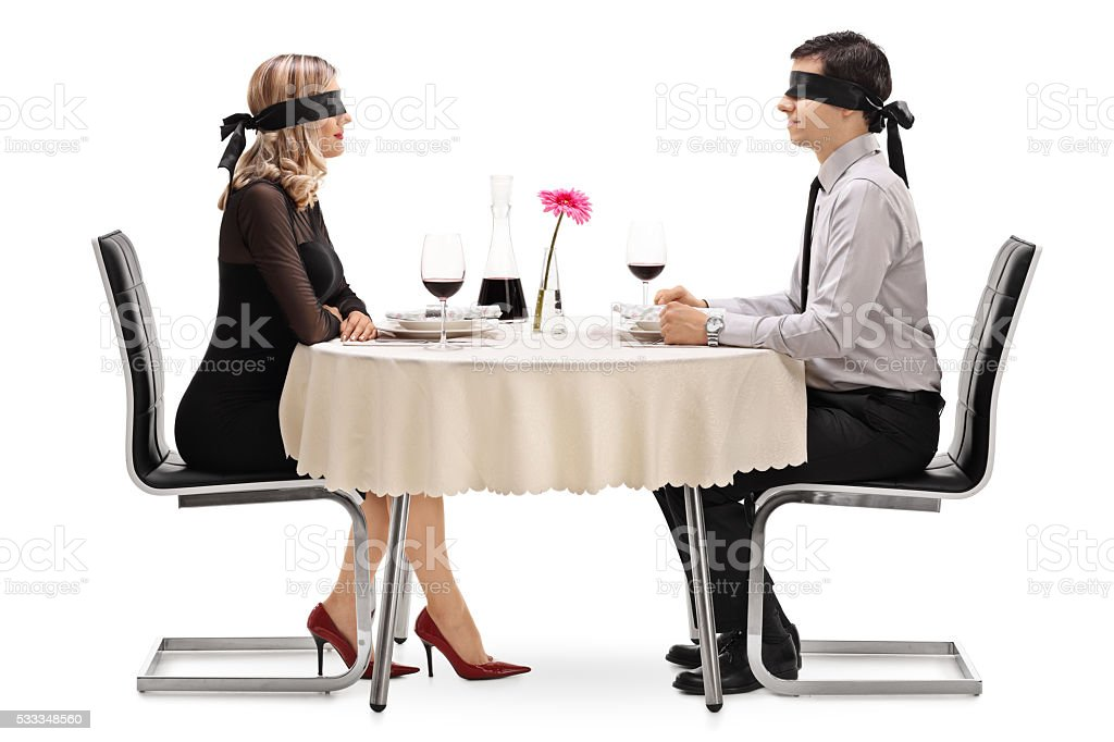 Young man and woman on a blind date stock photo
