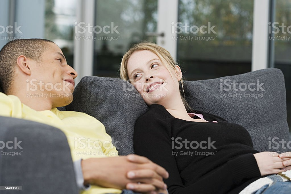 Young man and woman on sofa royalty-free stock photo