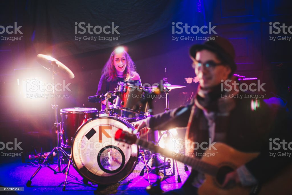 Young artists playing music and having fun on the stage