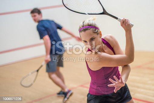 istock Young man and woman playing squash game 1006571226