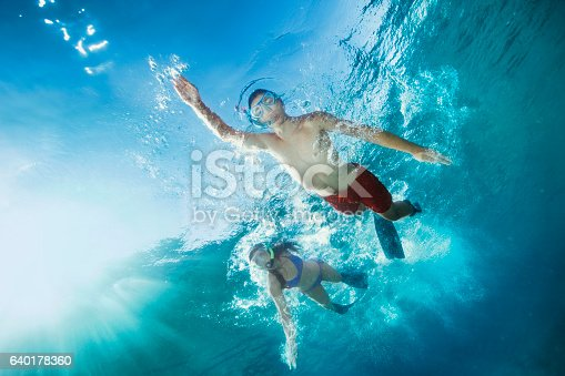 istock Young man and woman snorkeling  Underwater diving adventure  Turquoise sea 640178360