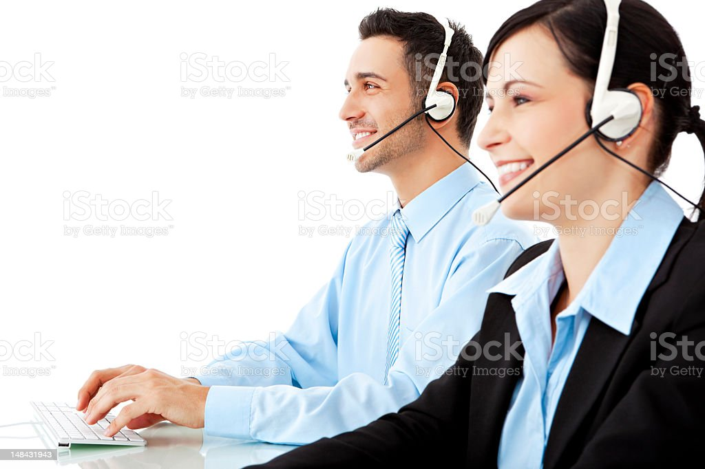 A young man and woman working as help desk operators stock photo