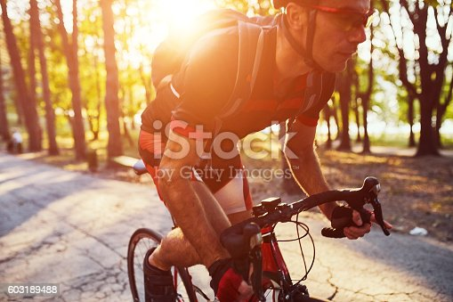 istock Young man are cycling road bike in the evening 603189488