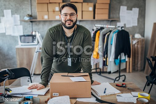 One man, overweight man arranging customers orders for drop shipping in warehouse.