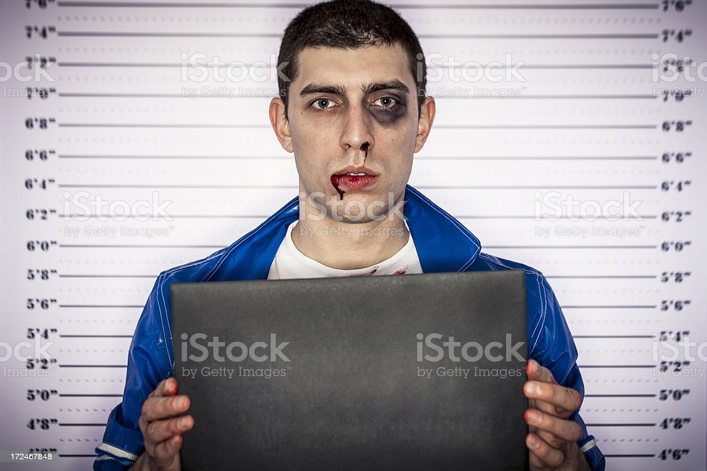 Young man arrested stock photo