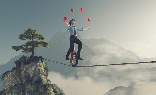 istock Young man as juggler 613559234