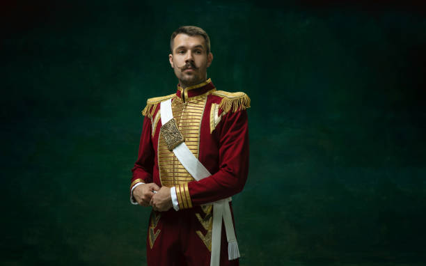 Young man as Nicholas II on dark green background. Retro style, comparison of eras concept. Thoughtful. Young man in suit as Nicholas II isolated on dark green background. Retro style, comparison of eras concept. Beautiful male model like historical character, monarch, old-fashioned. renaissance stock pictures, royalty-free photos & images