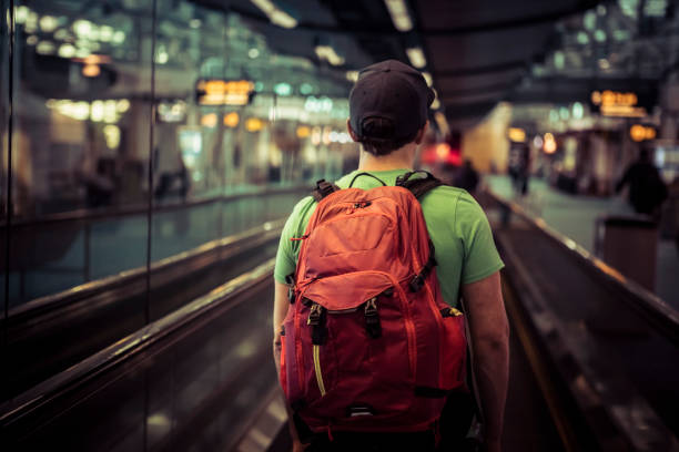 Young man at airport going on vacation. stock photo