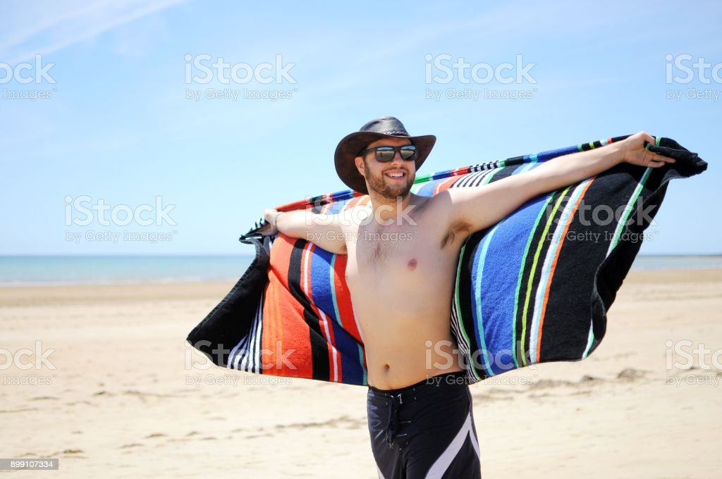 Young man at Australian Beach stock photo