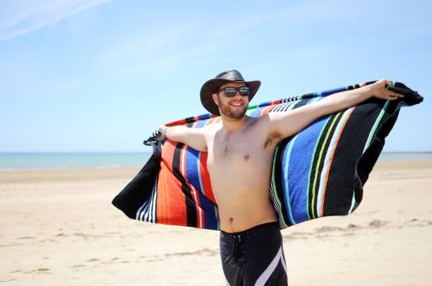 Young man at Australian Beach stock photo