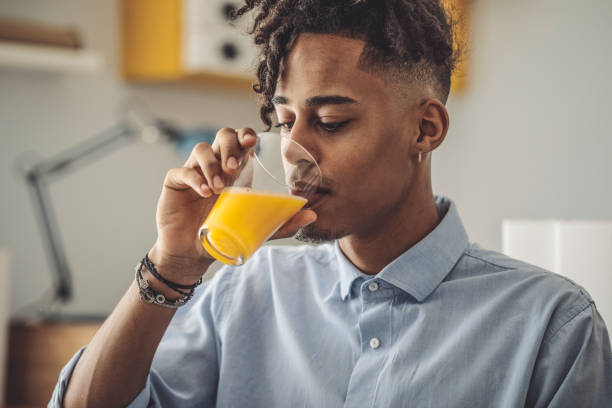 Young man at home stock photo