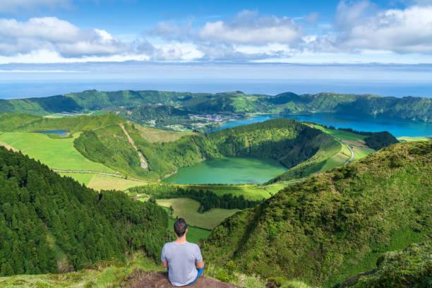 Young man at Sete Cidades lake in The Azores stock photo
