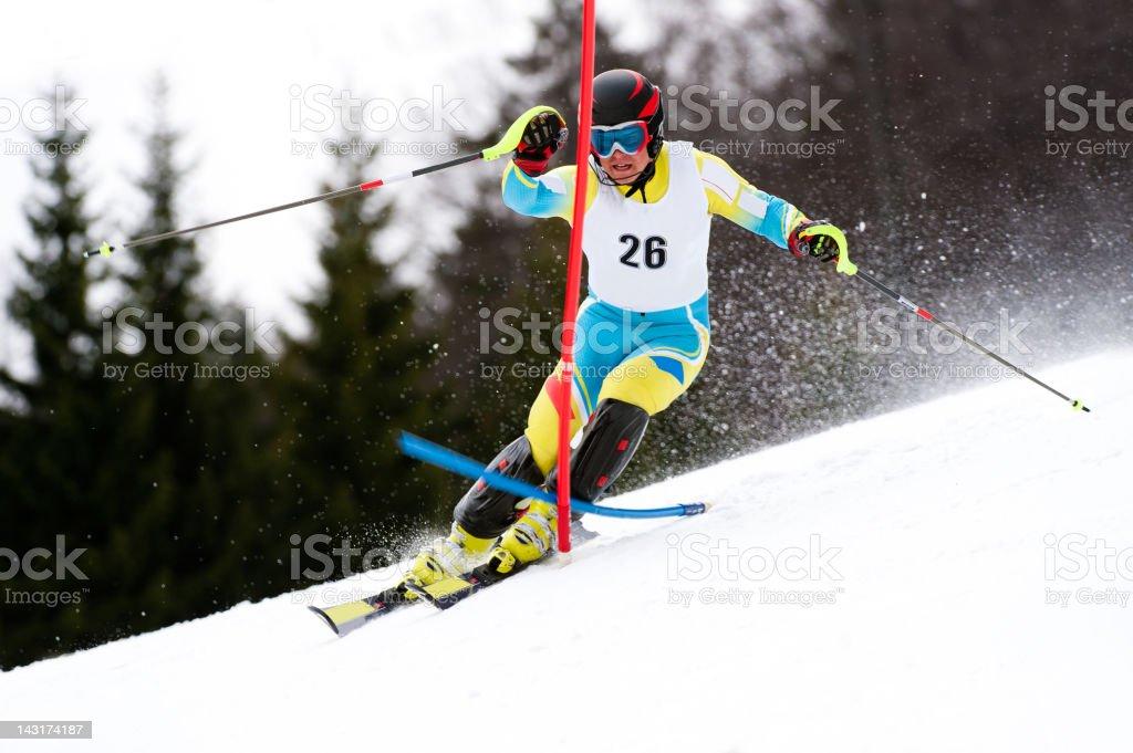 Young man at slalom ski race stock photo
