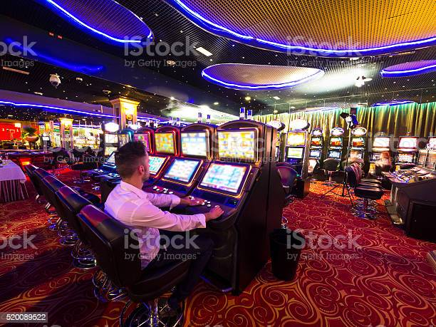 Young man at slot machine in casino picture id520089522?b=1&k=6&m=520089522&s=612x612&h=thg4fu0zjcoegqqw1ugso42o3bgzp36vzo2onert9ey=