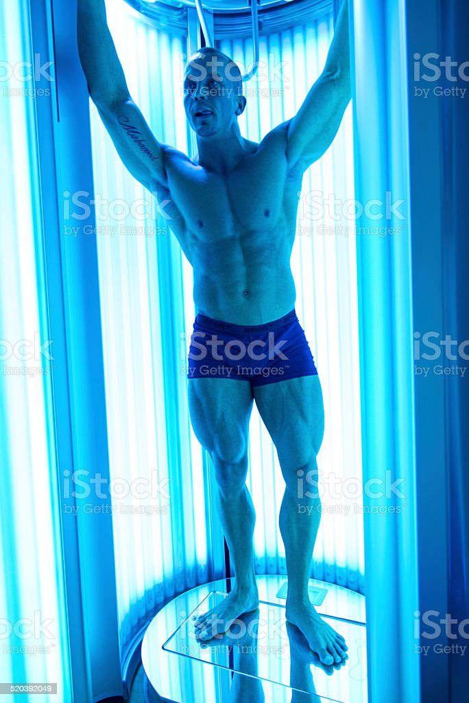 Young Man At Solarium In Beauty Salon stock photo