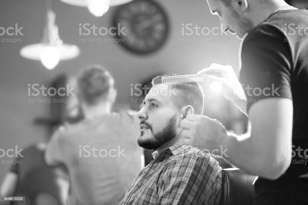Young man at the barbershop stock photo