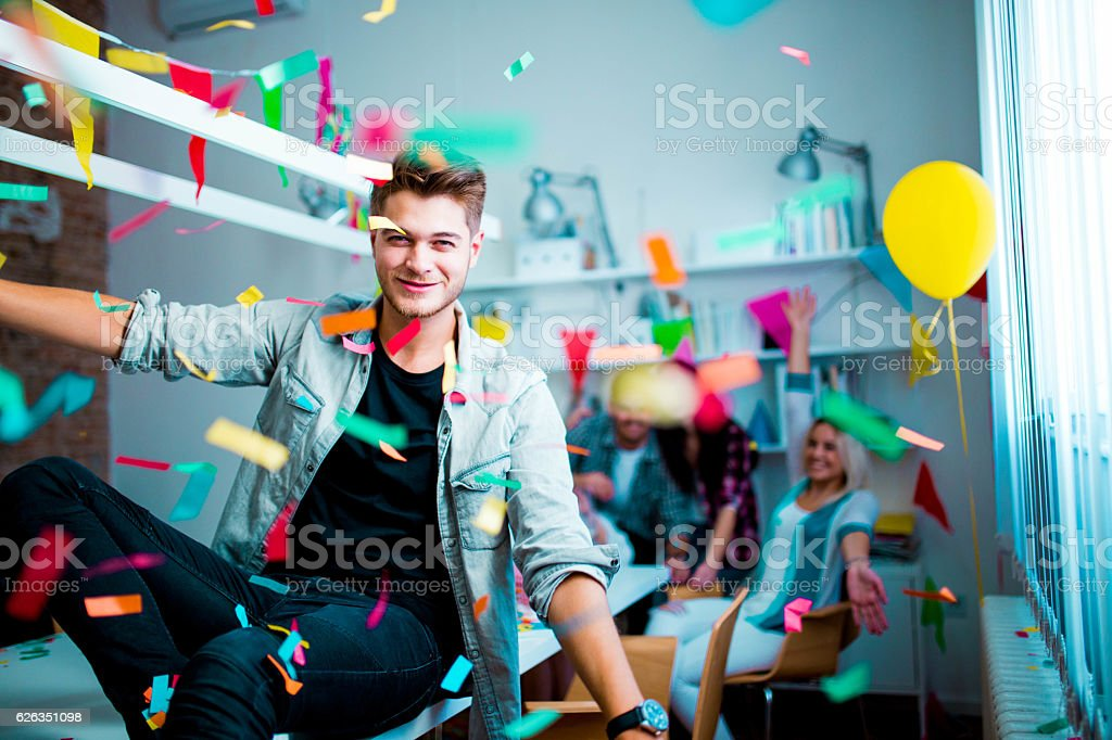 Young man at the birthday party - Photo