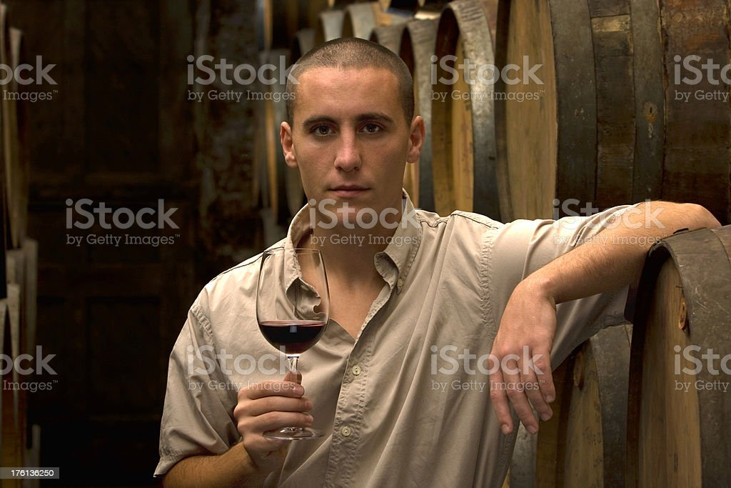 Young man at the cellar with glass royalty-free stock photo