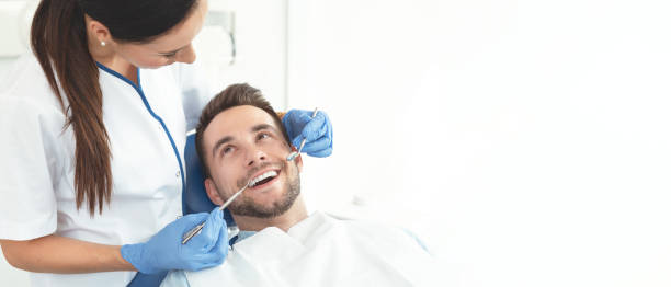 Young man at the dentist Young man at the dentist. Dental care, treatment of teeth, taking care of teeth dental health stock pictures, royalty-free photos & images