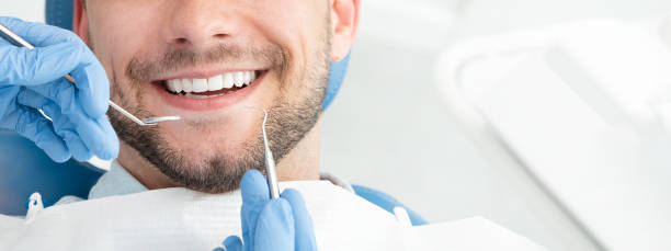 Young man at the dentist stock photo