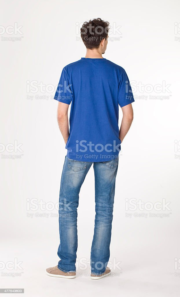 Young man back portrait in blue. stock photo