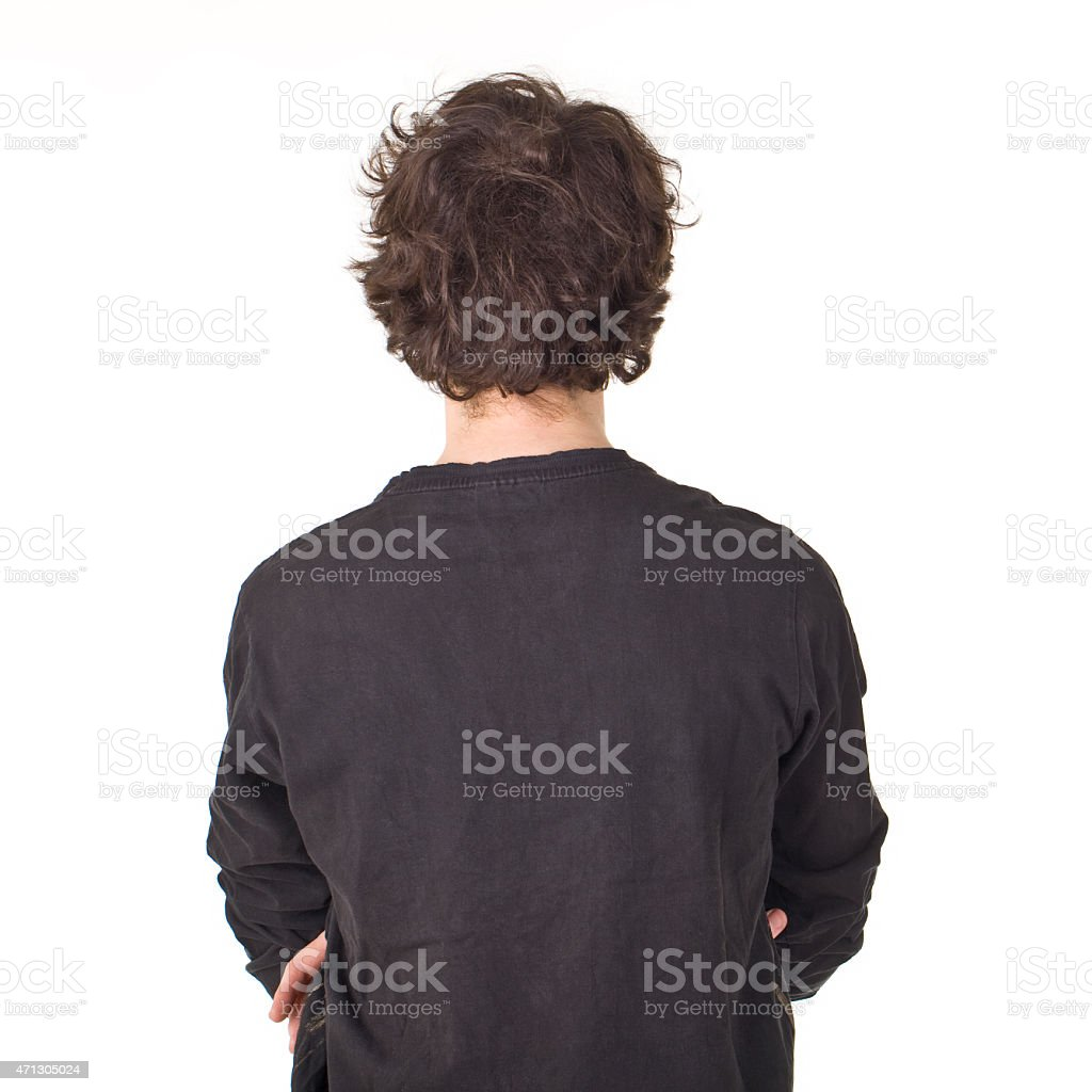 Young man back portrait with curly black hair. stock photo