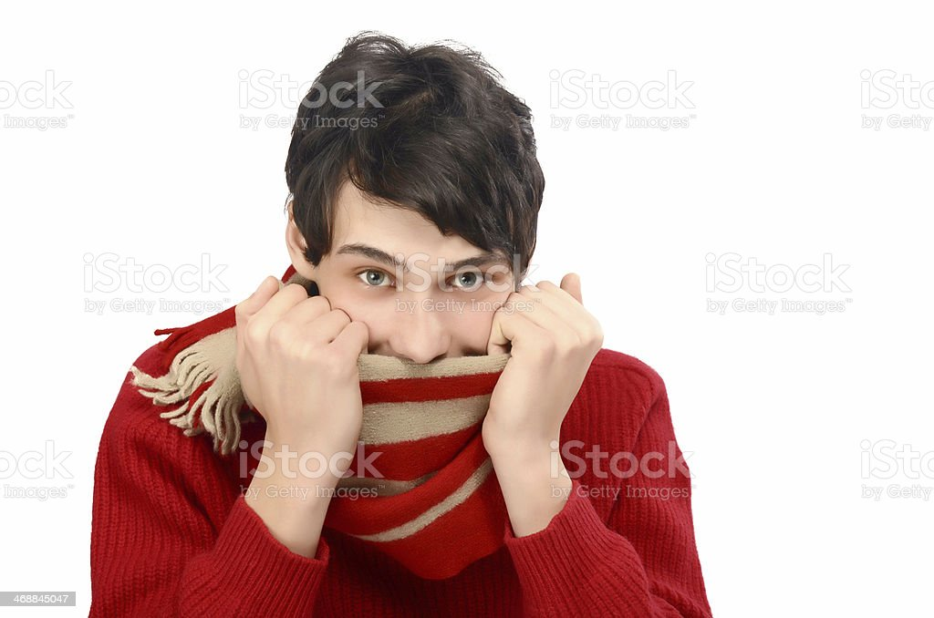 Young man being cold,puling his scarf on the face. stock photo