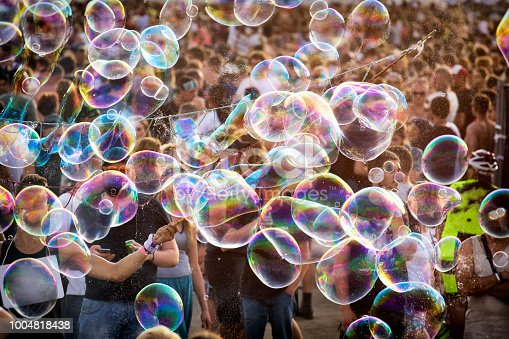 Young man blowing soap bubbles in the concrt - the biggest open air ticket free rock music festival in Europe