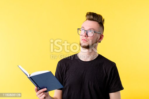 istock young man book looking up contemplation expression 1150835128