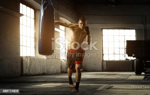 istock Young man boxing workout in an old building 488724805