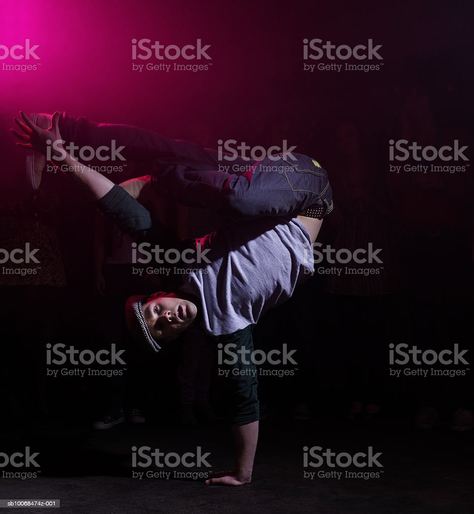 Young man break dancing at party royalty-free stock photo