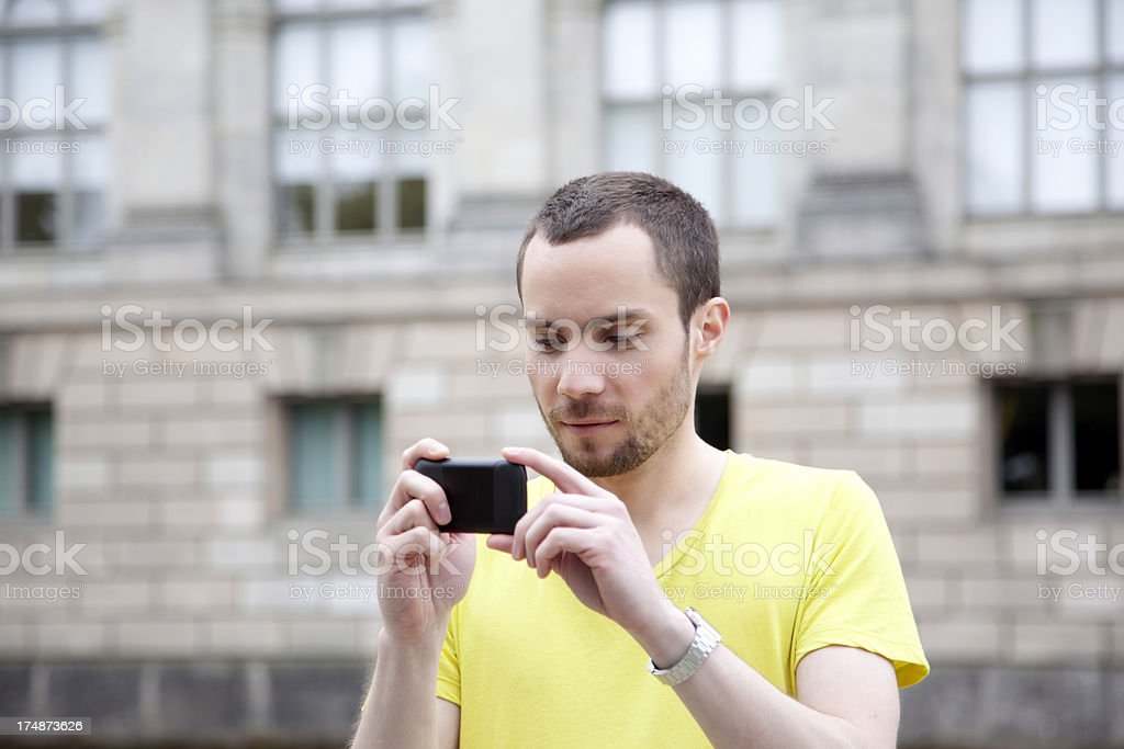Young man browsing mobile phone royalty-free stock photo