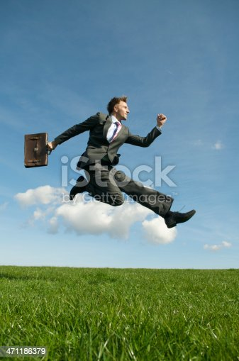 istock Young Man Businessman Jumping Outdoors Over Green Meadow 471186379