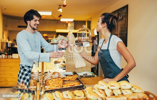 istock Young man buying bread at a bakery 639698310