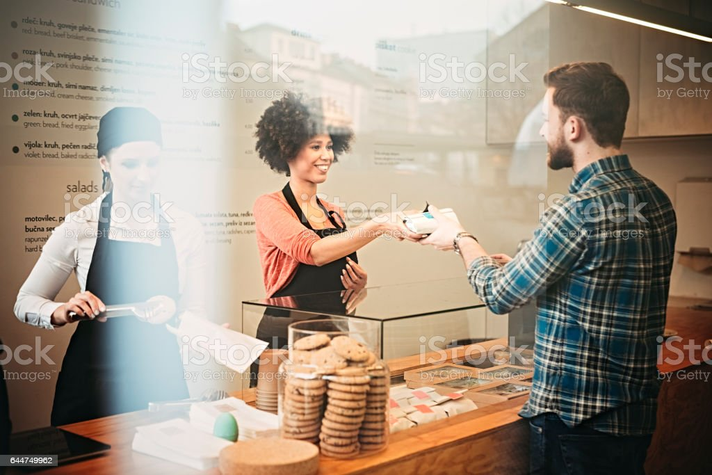 Young man buying   food  snack bar stock photo
