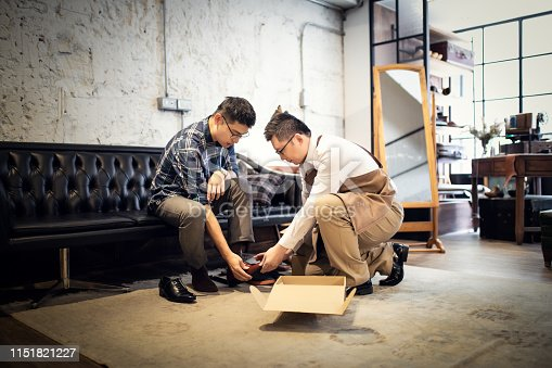 istock Young Man Buying New Shoes 1151821227