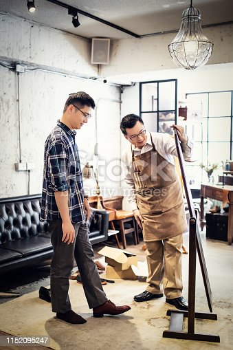 istock Young Man Buying New Shoes 1152095247
