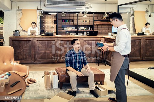istock Young Man Buying New Shoes 1152428314