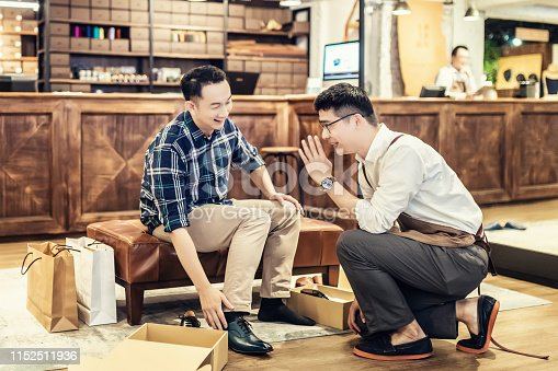 istock Young Man Buying New Shoes 1152511936