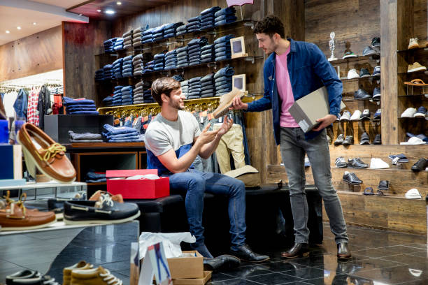 young man buying new shoes - menswear stock photos and pictures