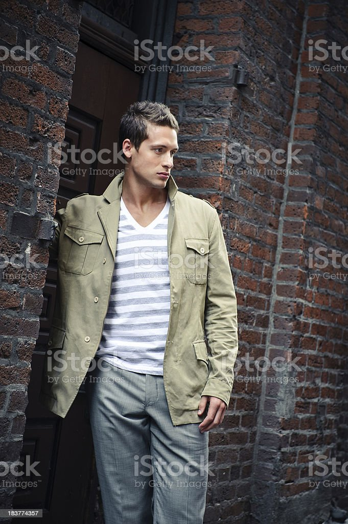 Young man by the door stock photo