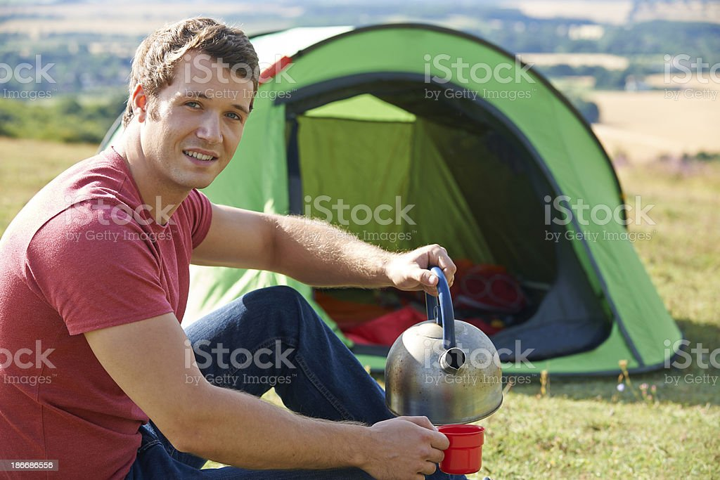 Young Man Camping In Countryside royalty-free stock photo