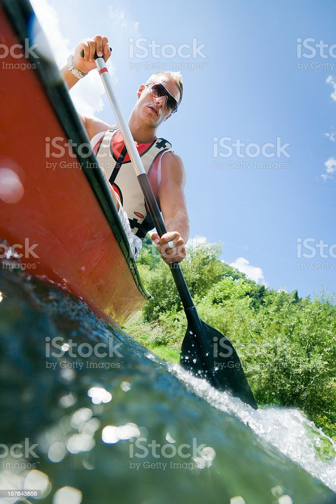 young man canoeing royalty-free stock photo