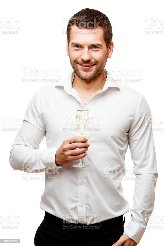 Jeune homme porte un verre de champagne - Photo