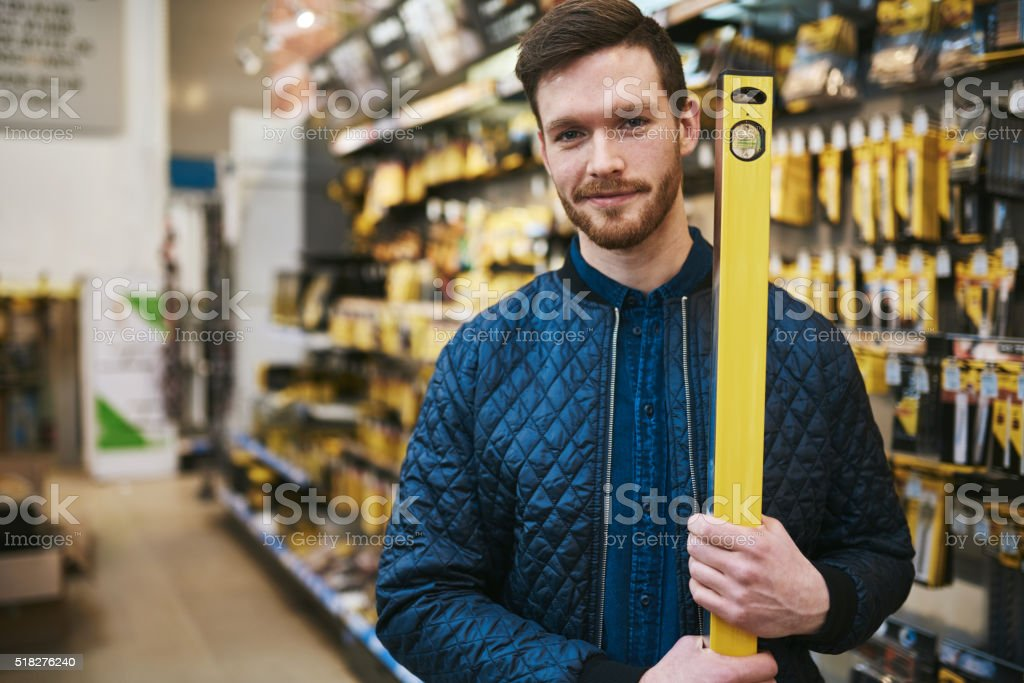 Young man carrying a builders or carpenters level stock photo