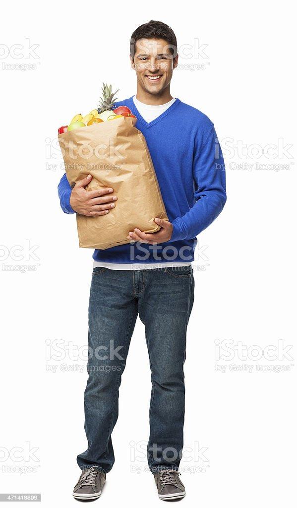 Joven llevando amplio bolsa de comestibles aislado - foto de stock