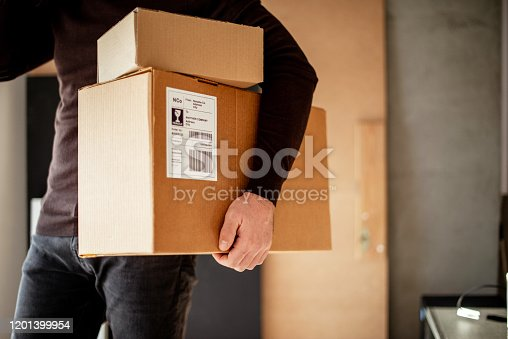 Young man carrying packages for shipment