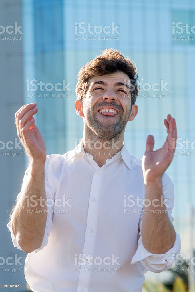 Young Man celebrate winning aplause stock photo