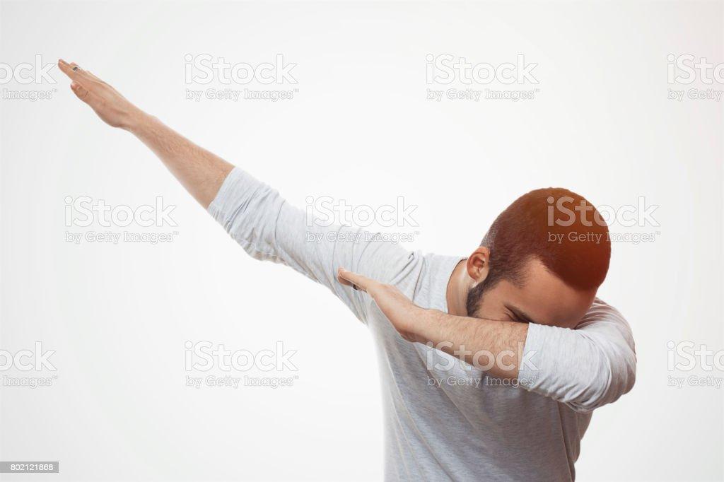 Young man celebrating stock photo
